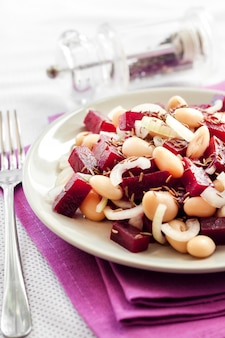 Beetroot salad with white kidney beans, pickles and onion