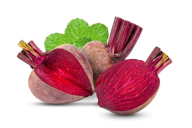 Beetroot slices with leaves on white table.