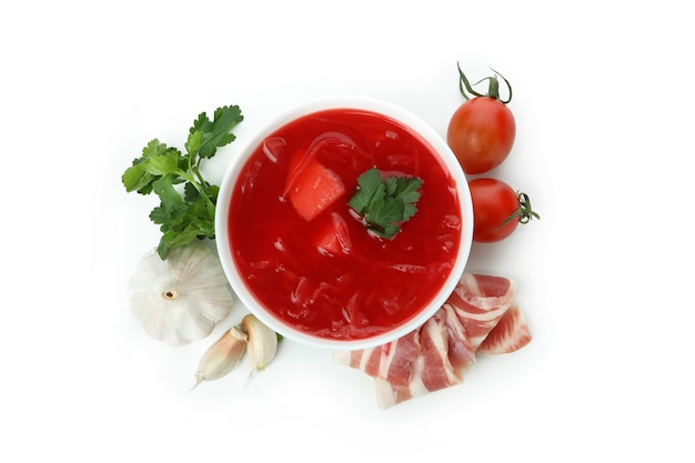 Beetroot soup and ingredients isolated on white surface