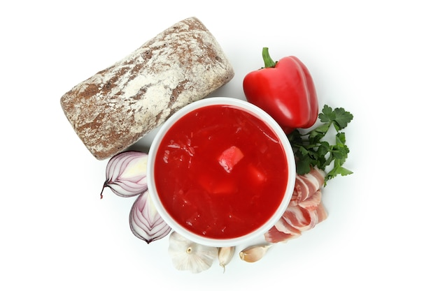 Beetroot soup and ingredients isolated on white