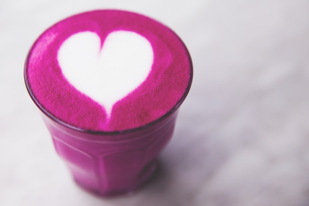 Beetroot super latte on marble background for love