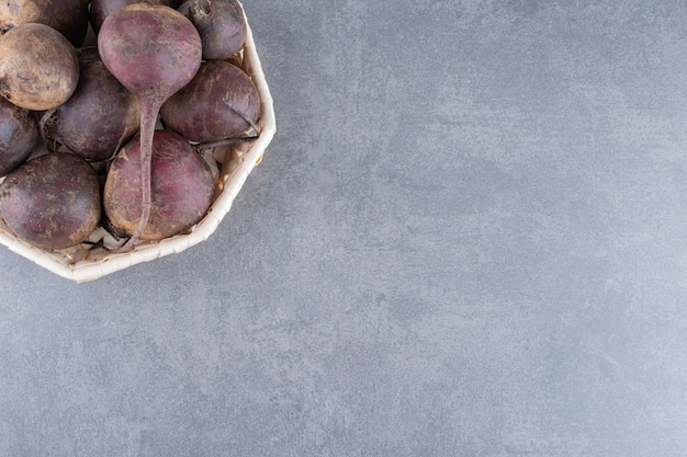 Beetroots isolated on the blue concrete surface