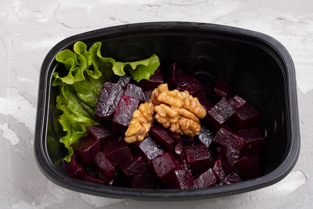 Beets, nuts, turnips, parsley and onion salad in black box