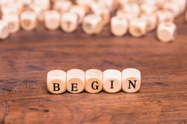 Begin word on wooden cubes