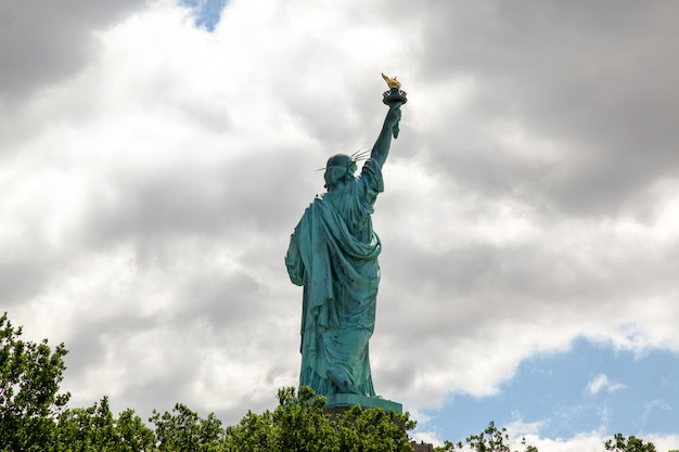 Behide the statue of liberty is american symbol have famous in new york, usa