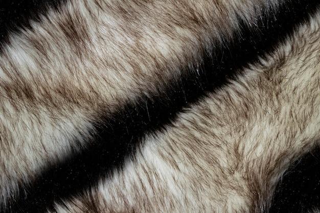 ベージュと黒のきれいなwnatural毛皮の背景