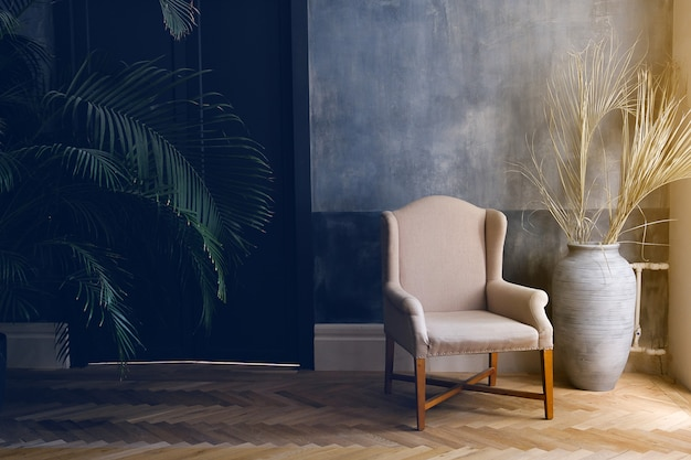 Beige armchair and a blue vase stand by the window in the living room