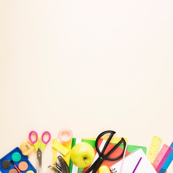 Beige background with school supplies