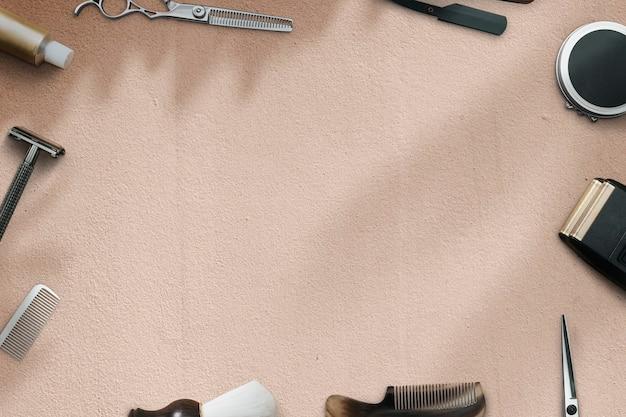 Fondo beige della carta da parati del barbiere con gli strumenti, il lavoro e il concetto di carriera