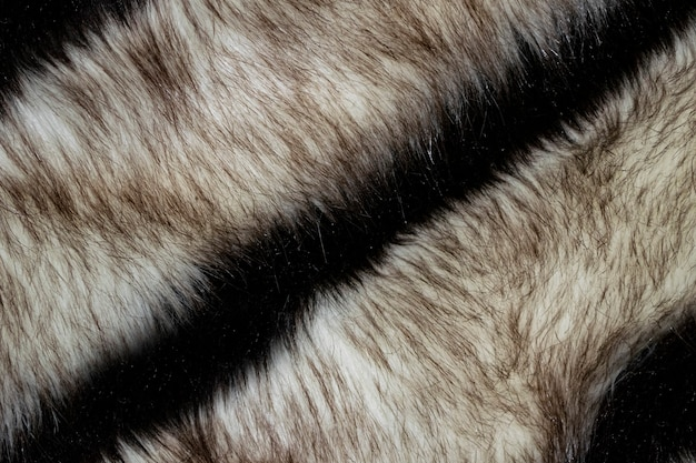 Beige and black clean wnatural fur background