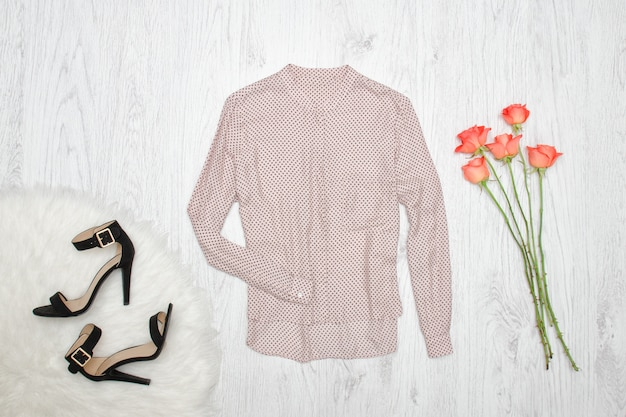 Beige blouse, shoes and orange of roses
