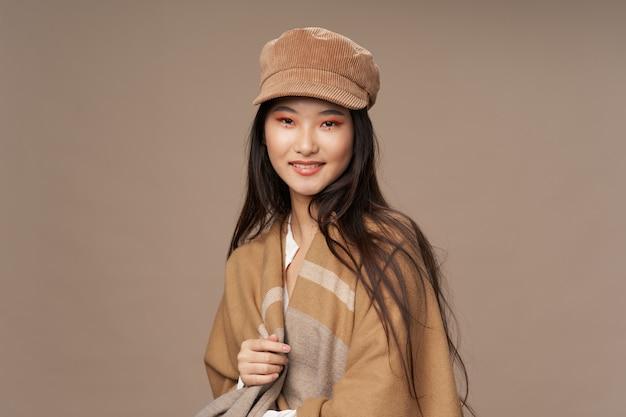 Beige cap fashionable woman warm plaid makeup