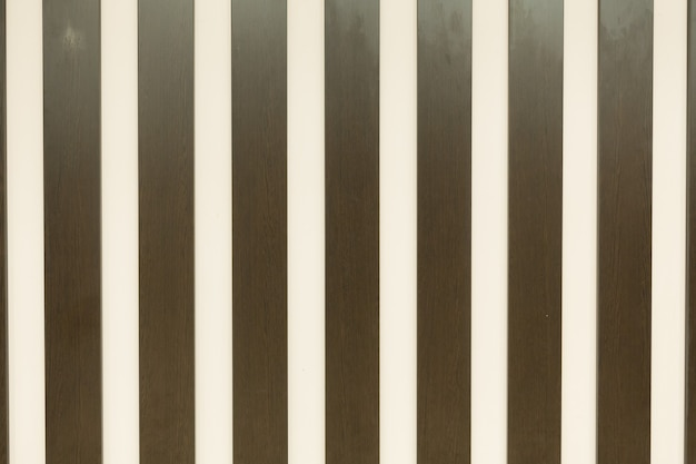 Beige color background with colored vertical stripes, shades of brown and white