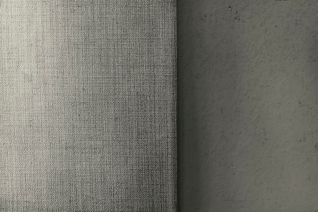 Beige concrete and canvas fabric textured background