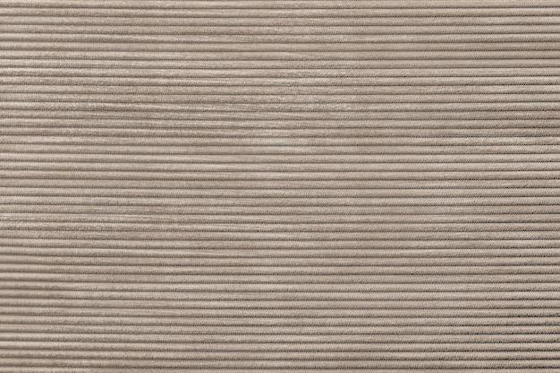 ベージュのコーデュロイ生地の織り目加工の背景