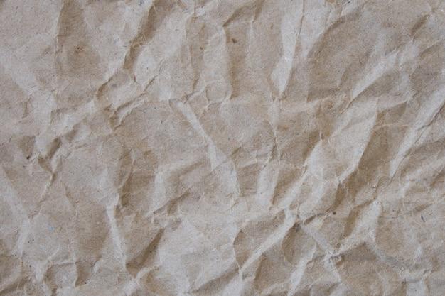 Текстура бежевой мятой бумаги