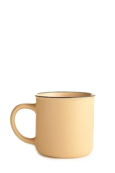 白い背景に分離されたベージュのカップ。上面図