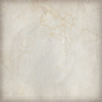 Beige dirty paper texture or background in spots