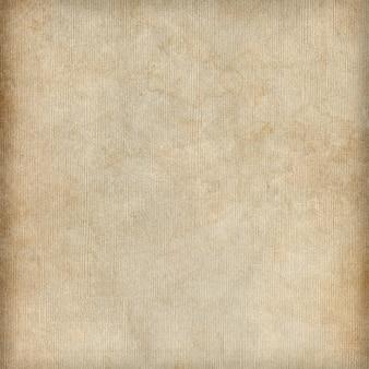 Текстура бежевой грязной бумаги или фон