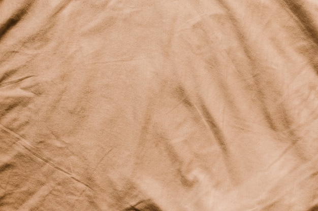 Beige fabric close-up background