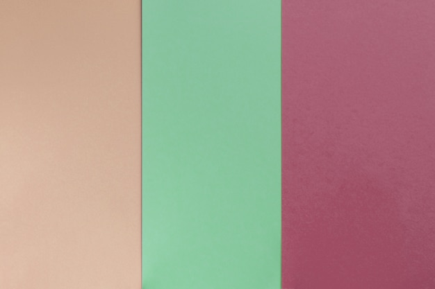 Beige green bordo colored paper background. geometric flat composition.