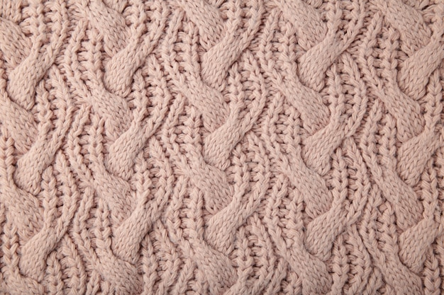 Beige knitted texture or background. top view