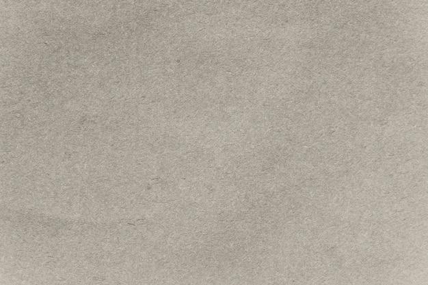 ベージュのクラフト紙の織り目加工の背景