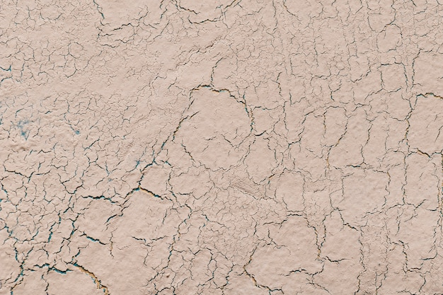 Beige lime plaster with cracks background