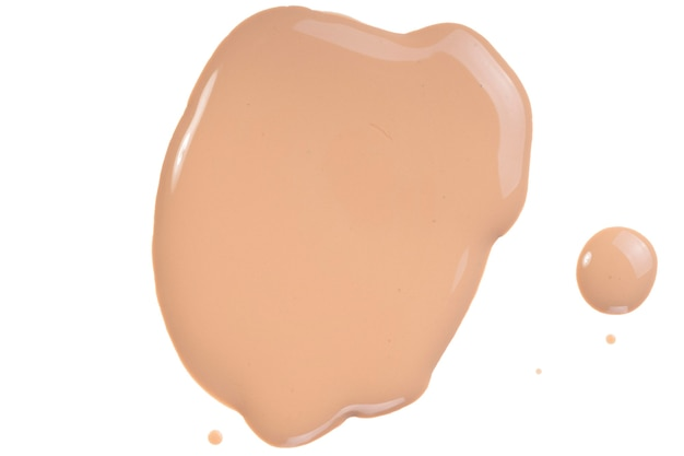 Beige liquid foundation, concealer smear smudge drop