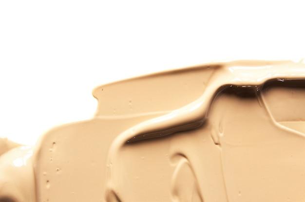 Beige makeup smear of creamy foundation