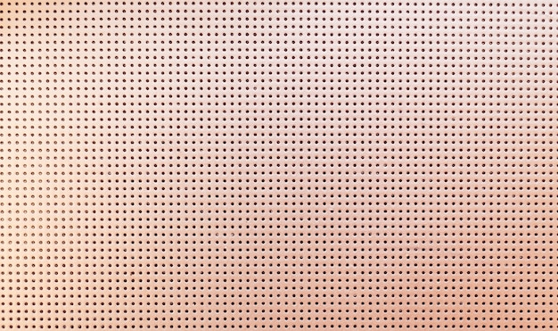 Beige metallic perforated leather texture