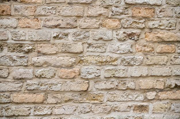 ベージュの古いレンガの壁の背景グランジテクスチャ