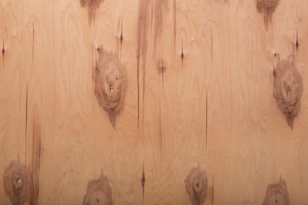ノットとベージュの古い木材のテクスチャ