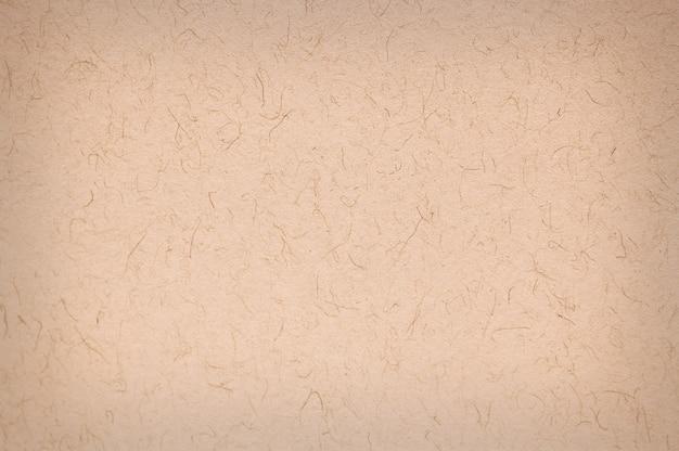 ベージュの紙テクスチャ背景スクラップブッキング