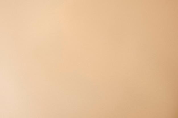 シンプルなスタイルのベージュの紙のテクスチャ背景