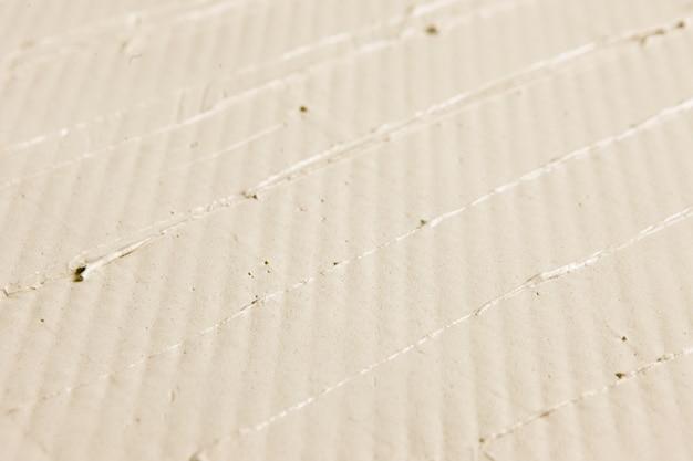 베이지 색 파스텔 컬러 릴리프 치장 벽 토 벽 근접 촬영 석고 질감 추상적 인 배경 여유 공간 디자인 수리 개념