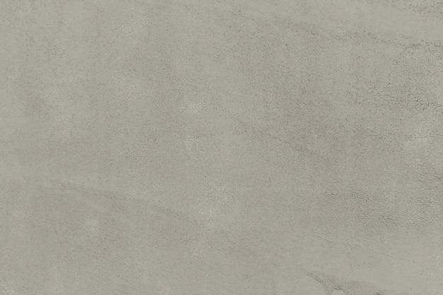 ベージュの無地のコンクリートの織り目加工の背景