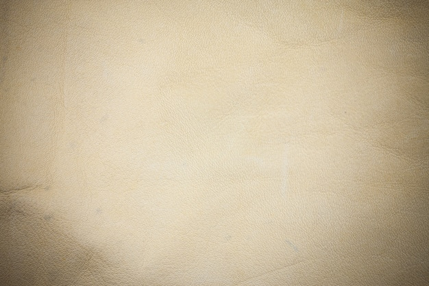Beige real leather background.