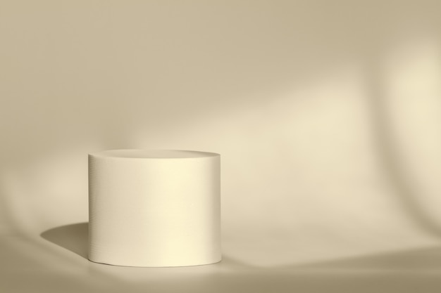Beige round pedestal podium for packaging presentation on backdrop with room shadows from