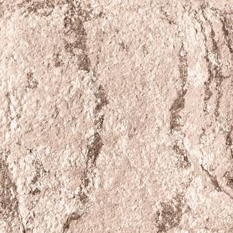 ベージュの光沢のある織り目加工紙の背景