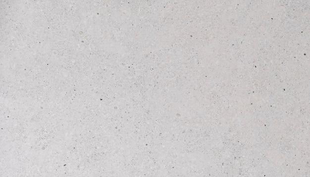 Бежевый каменный фон, естественная текстура травертина крупным планом
