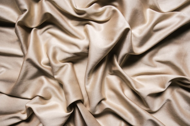 Beige textile abstract background. close up