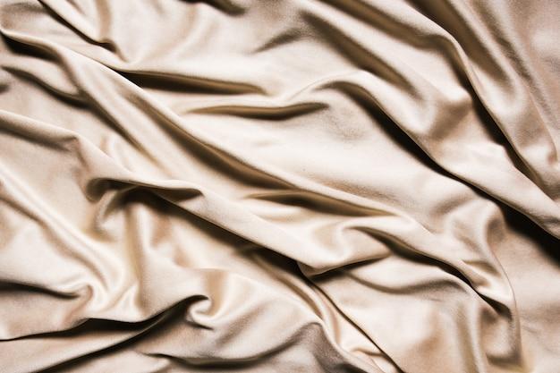 베이지 색 섬유 추상적 인 배경입니다. 확대