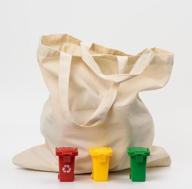 Beige textile bag on a pink background, no plastic, zero waste