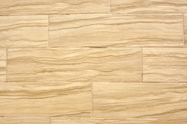 Beige tiles on the wall background