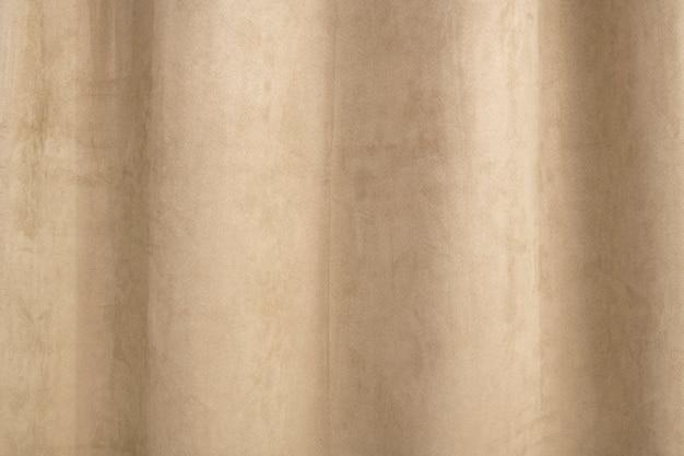 デザインスペースとベージュのベルベットのカーテンの背景