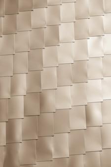베이지색 비닐 타일 벽 배경입니다. 세로 비네팅 샷