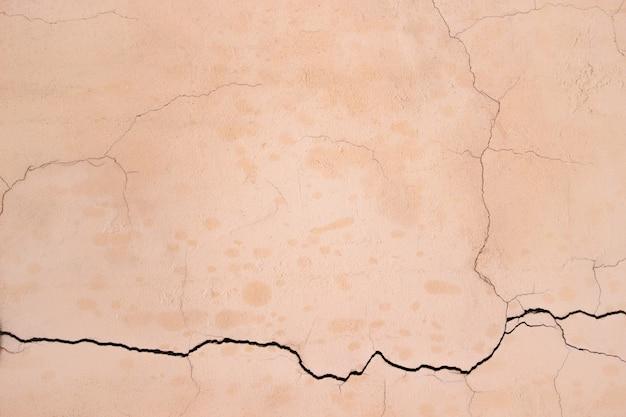 ベージュの壁の質感、壁の色のコンクリート、セメントの抽象的な構造