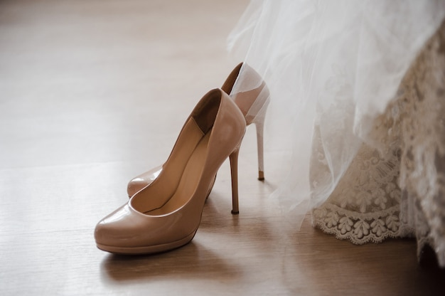 Beige wedding shoes. bride's dress.