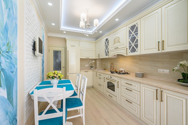 Beige, white and cyan contemporary classic kitchen inrerior designed in provence style, all furniture with open doors and drawers